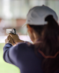 woman shooting hand gun